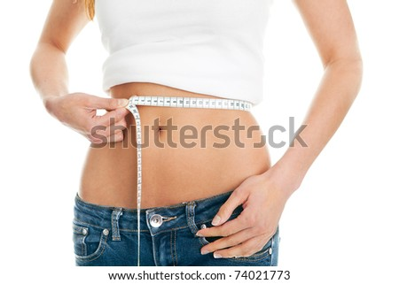 Beautiful woman measuring waist. Isolated on white
