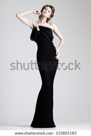 Stock Photo beautiful woman model posing in elegant dress in the studio