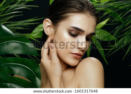 beautiful woman naked shoulders and green leaves charm exotic exotic clean skin