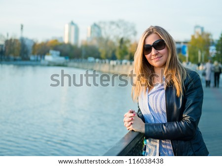 beautiful  woman near fence