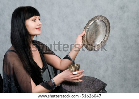 Beautiful woman of forty-five years   and silver wineglass