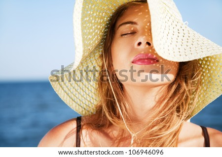 Beautiful woman on a beach on a sunny day