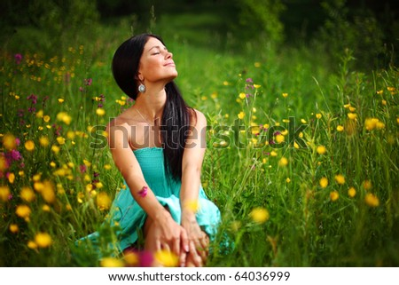 beautiful woman on flower field