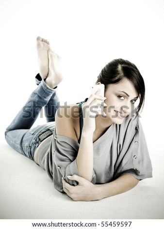 Beautiful woman on phone with a very confident, freindly smile.