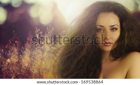 Beautiful woman on sunlight. Hair product and makeup product model