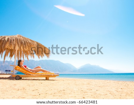 beautiful woman on the background of the beach