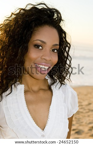 Beautiful woman on the beach at sunset