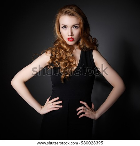 Beautiful Woman on the Dark Background of Dark Wall