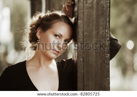 Beautiful woman on the porch