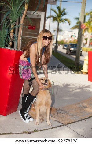 Beautiful woman outdoors with her dog.