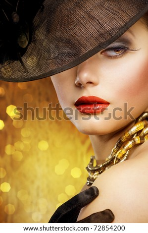 Beautiful Woman over luxury gold background