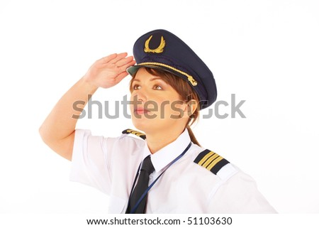 Beautiful woman pilot wearing uniform with epauletes, hat with golden wings looking ahead, standing isolated on white background.