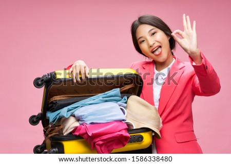 Beautiful woman pink coat travel charm airport lifestyle lifestyle isolated background