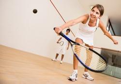 Beautiful woman playing a match of squash