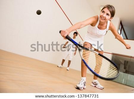 Beautiful woman playing a match of squash ストックフォト ©