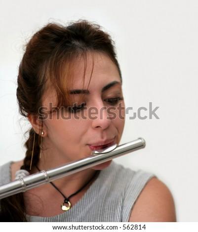 Beautiful woman playing flute