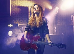 Beautiful woman playing the guitar