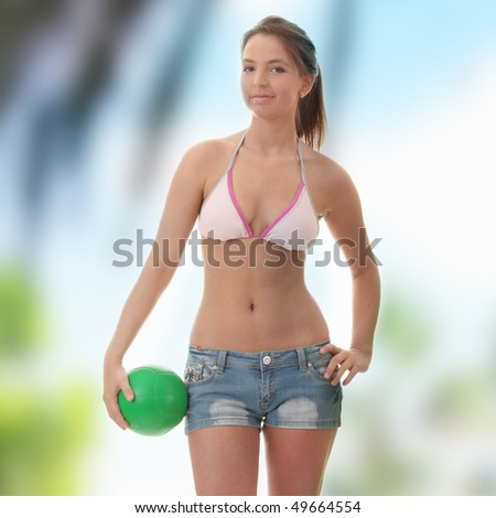 Beautiful woman playing volleyball (beach ball)