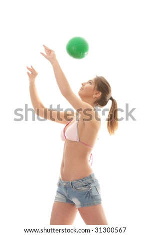 Beautiful woman playing volleyball (beach ball) isolated on white background