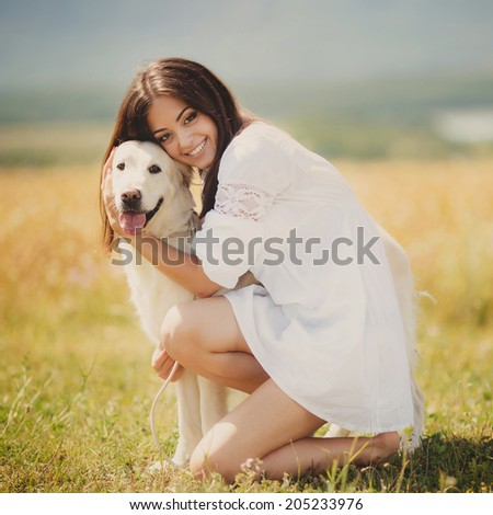 Beautiful woman playing with her ??dog. Outdoor portrait. series. young woman with dog outdoor day portrait