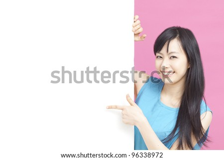 Beautiful woman pointing blank white board.