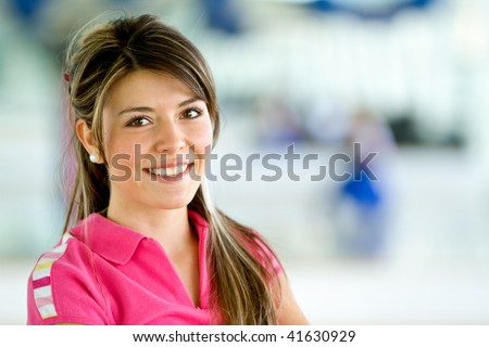 beautiful woman portrait at the gym smiling