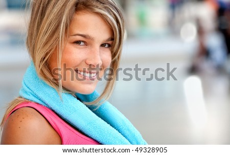 beautiful woman portrait at the gym smiling #49328905