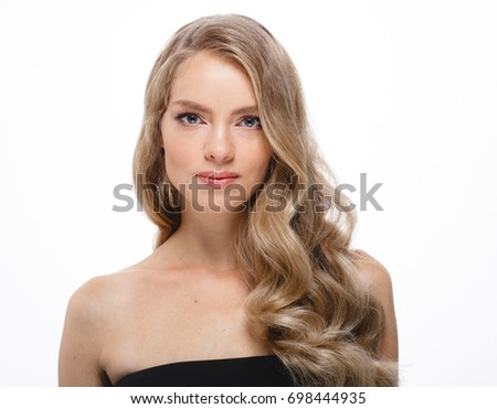Beautiful woman portrait. Beautiful girl with long wavy hair. Blonde model with hairstyle beauty skin care concept isolated on white