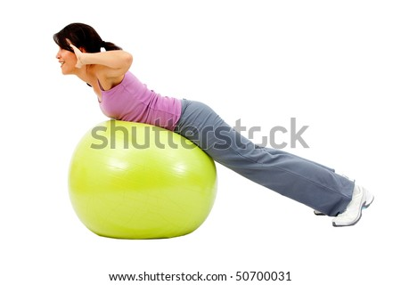 beautiful woman portrait exercising on a pilates ball - Isolated over a white background