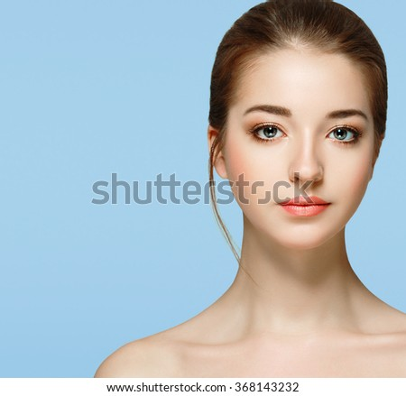 Stock Photo Beautiful woman portrait face studio isolated on blue