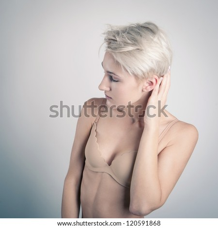 Beautiful woman portrait in beige bra isolated.