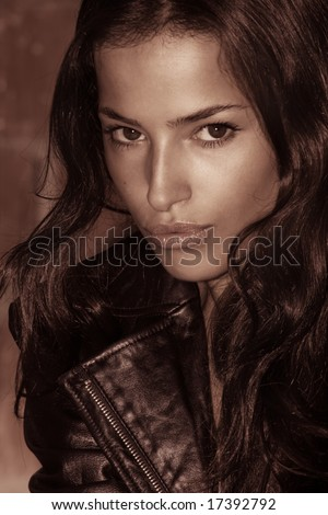 beautiful woman portrait in leather jacket, outside