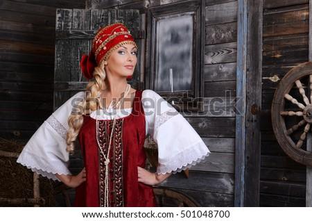 Beautiful woman portrait in russian style. Beautiful Russian girl in traditional dress. Russian style. #501048700