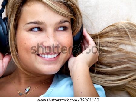 Beautiful woman portrait with headphones smiling indoors