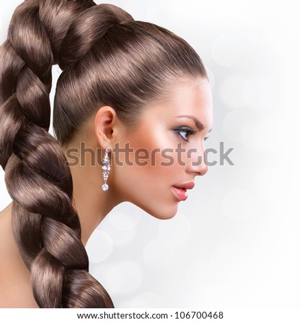 Beautiful Woman Portrait with Long Healthy Hair.