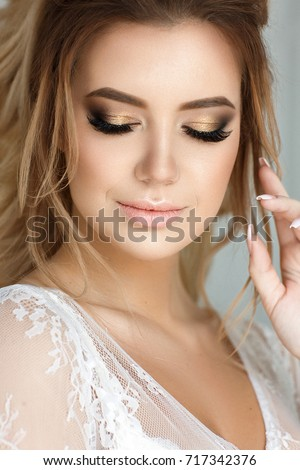 4c558a49fc1 Beautiful woman portrait with tender make up and elegant hairstyle. Bride.   717342376