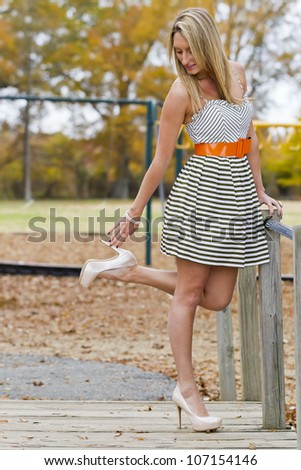 Beautiful woman posing in an outdoor environment