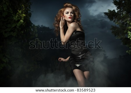 Beautiful woman posing on evening background