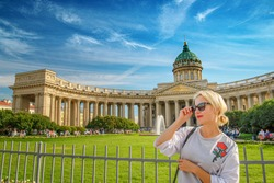 Beautiful woman posing over Kazan Cathedral in St. Petersburg