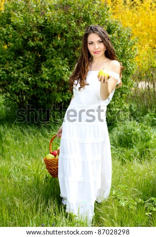Beautiful woman present apples.Go to you on the Nature
