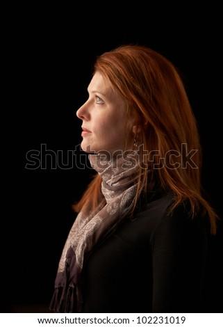 Beautiful woman profile portrait red hair