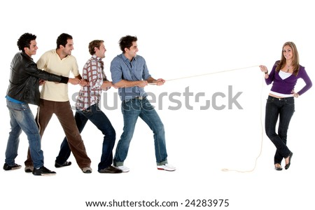 Beautiful woman pulling a rope against a male team -  isolated on white - stock photo