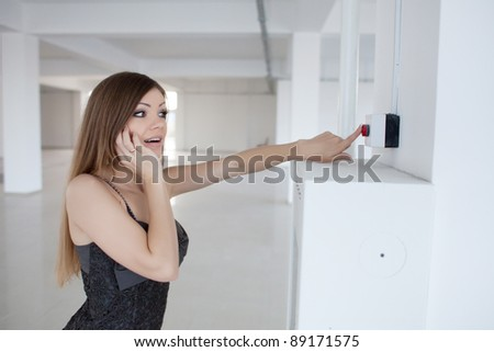 beautiful woman push the red button