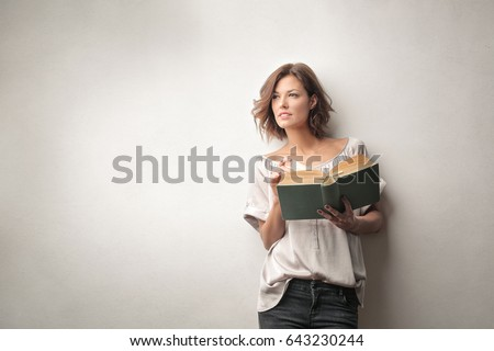 Beautiful woman reading a book #643230244
