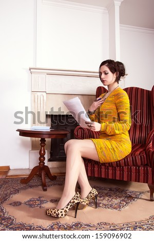beautiful woman reading a love letter
