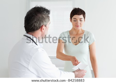 Beautiful Woman receiving a prescription in a room