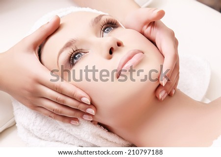 Beautiful woman receiving facial massage and spa treatment