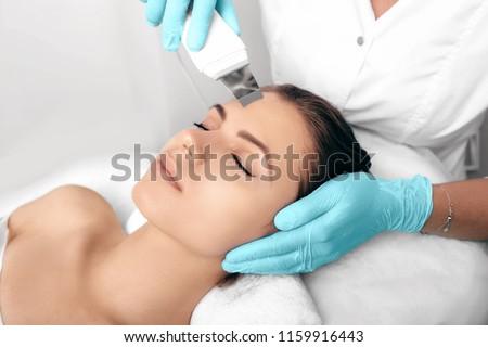 Beautiful woman receiving ultrasound cavitation facial peeling. Cosmetology and facial skin care. facial treatment, face cleansing