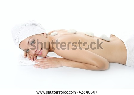 Beautiful woman relaxed on spa with stone treatment, white background