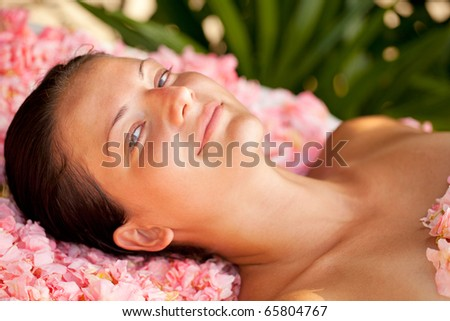 Beautiful woman relaxing and looking at the camera